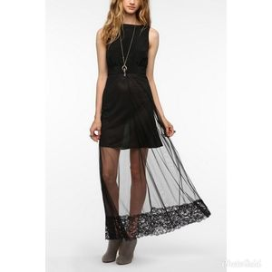 Black dress with a keyhole back and lace skirt